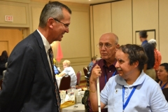 John Polanowicz, Secretary of EOHHS talks to attendee from STAVROS