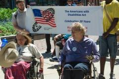 Karen Schneiderman and David Hockenberry lead the march