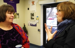 Julie and Mary Anne Padien from Karen Spilka's office talk.