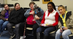Keolise visits with Kristal, another guest, Lori, Shivers, the service dog,and Norma.