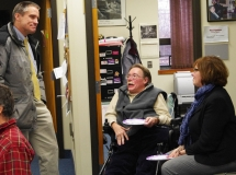 Executive Director Paul Spooner speaks with a Framingham engineer and Mary Anne Padien about the accessible ramps being added to the Memorial building.