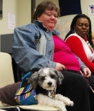 Lori and her service dog, Shivers, enjoy the party!