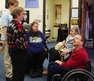 Mike Kennedy and Tammy Laverty, MWCIL Board members, talk to Jini and Edwina.