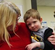 Pat holds her grandson, Mason.