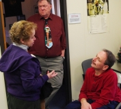 Mike Kennedy, MWCIL Board member, talks to a friend while Bob thinks about life.