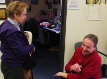 Mike Kennedy, a MWCIL Board member, and a friend laugh.