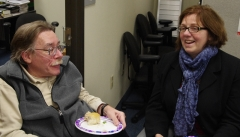 Executive Director, Paul Spooner chats with Mary Anne Padien from Karen Spilka's office.