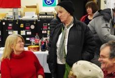 Pat enjoys talking to Peggy as Jim looks on.