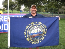 Dave from MWCIL is holding New Hampshire state flag.