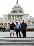Dave from MWCIL, Andy from Boston CIL and William from IA pose in front of the Capital.