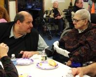 Joe Bellil, MWCIL Board President and V.P. at Easter Seals, talks to Disability Activist, Sybil Feldman