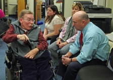 Paul Spooner, Executive Director of MWCIL, talks to Ed Carr of the MWRTA