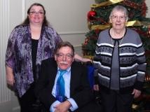 Wini McGraw of IA, Margaret Spooner, and Paul Spooner, Executive Director of MWCIL