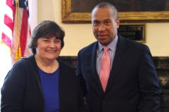 Rose Quinn, Assistant Director at MetroWest Center for Independent Living, poses with Governor Deval Patrick.