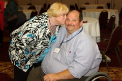Mary Margaret Moore, Executive Director of Independent Living Center of the North Shore and Cape Ann Inc., and Joe Bellil of the Easter Seals, and the MWCIL Board of Directors.