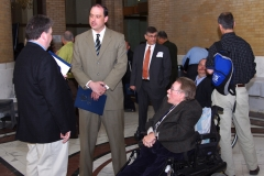 Steve Higgins, Executive Director of IACIL, James Eldridge, State Senator, and Paul Spooner, Executive Director of MWCIL