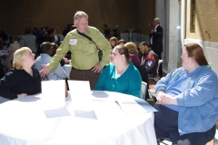 Bill Allan, Director of Policy and Advocacy at the Disibility Policy Consortium, in green.