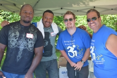 William and Manel (IA), Jim ( MASILC), and Dave ( MWCIL) hand out tees.
