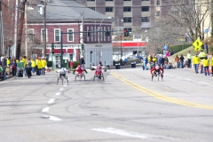 Four wheelchair racers coming up the hill in Wellesley