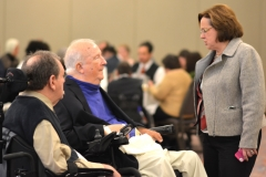 MRC Commissioner Charlie Carr (l) and former Commissioner Elmer Bartels with Rosalie Edes of Disability Policy and Programs