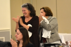 Jean McGuire of Northeastern and Rosalie Edes of the Office of Disability Policy and Programs applaud Bill and Liz