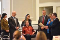 MetroWest legislators present Liz Casey with a citation