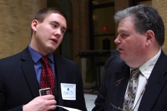 Christopher Yancich, aid to State Rep. Jeffrey Roy, speaks to Steve Higgins, Executive Director of IACIL