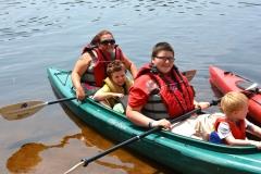 family in kayak