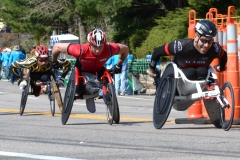 three wheelchair racers
