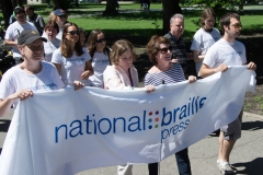 People carrying National Braille Press banner