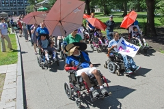 Disability Pride - several marchers in wheelchairs