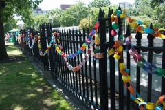 paper chain of disability messages on fence