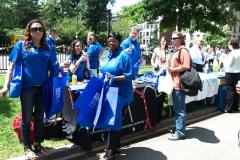 women giving out ADA 25 bags