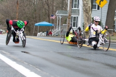 Two handcyclists and a wheelchair racer