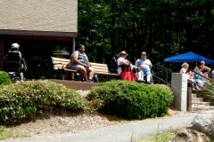 People relaxing on a bench in the sun