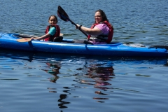 A woman and girl in a kayak
