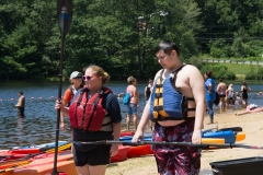 woman and boy ready to kayak