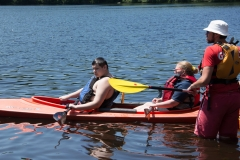boy and woman in kayak