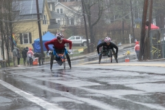 2 wheelchair racers coming up the hill