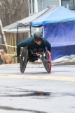 Front photo of man racing in wheelchair