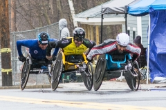 Photo of 3 wheelchair racers