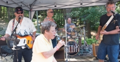 woman sings along with ATTIK band