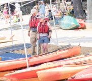 Couple gets ready to kayak