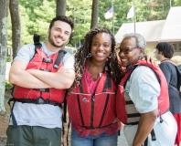 Three people ready to kayak