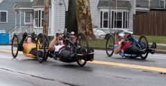 3 handcyclists with no visible numbers