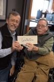 Kirk Joslin hands Paul the Quid Pro Quo!