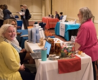 Attendees look at exhibits