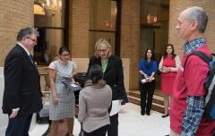 Senate President Karen Spilka talking to Steve Higgins (IA) and Jennifer Lee (STAVROS and MASILC)