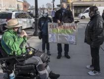 "Chris Hoeh, Anne Fracht, Rick Glassman and woman.  Sign: ""Illuminate History"""
