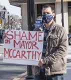"""Advocate with sign: """"Shame on Mayor McCarthy"""""""